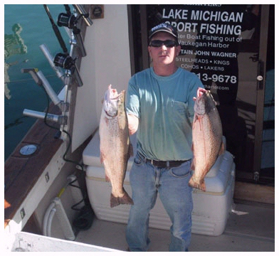 Captain John Wagner Chicago Fishing Charter holding two fish